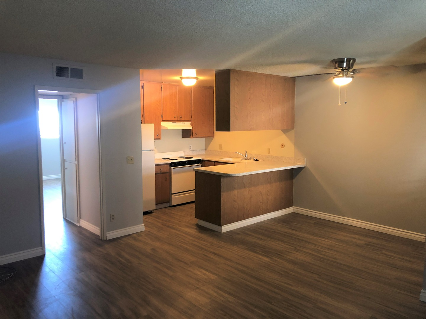 Inside of the living room and kitchen at 2265 Needham Road, #3, El Cajon, CA 92020