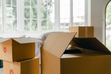 unpacked boxes in middle of room